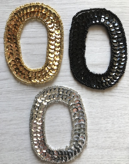 Numero 0 in paillettes e perline oro